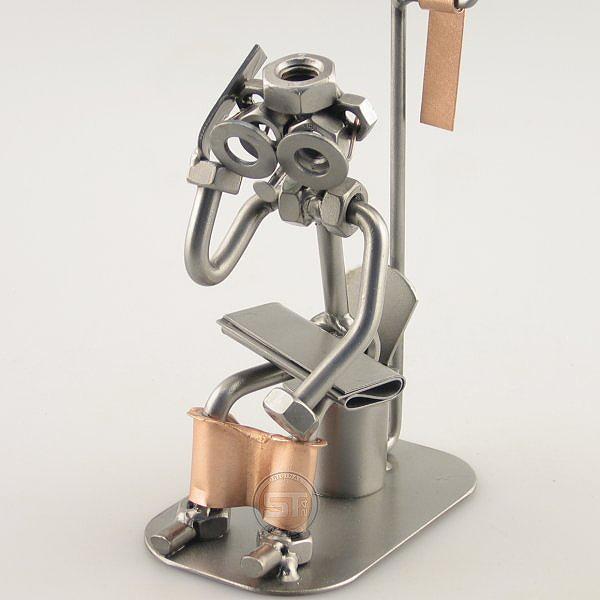 Steelman sitting in the Restroom holding a Mobile Phone metal art figurine