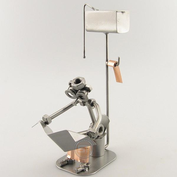 Steelman sitting in the Restroom reading metal art figurine