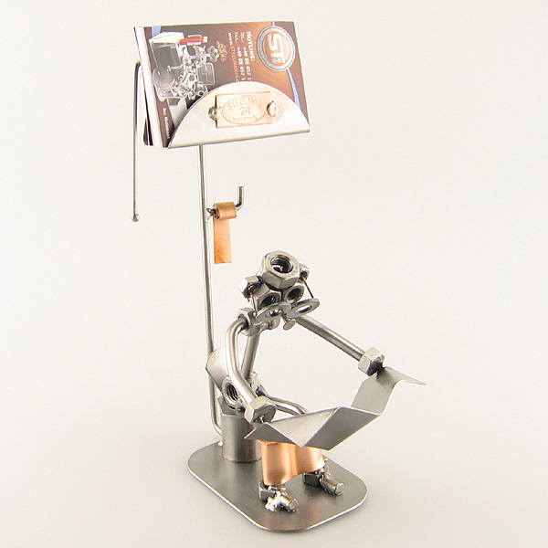 Steelman sitting in the Restroom reading metal art figurine with a Business Card Holder