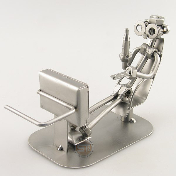 Steelman holding a beverage metal art figurine with a TV Remote Control Holder