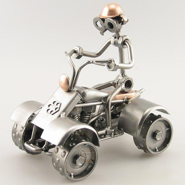 A photo of a Steelman riding a Four Wheeler metal art figurine