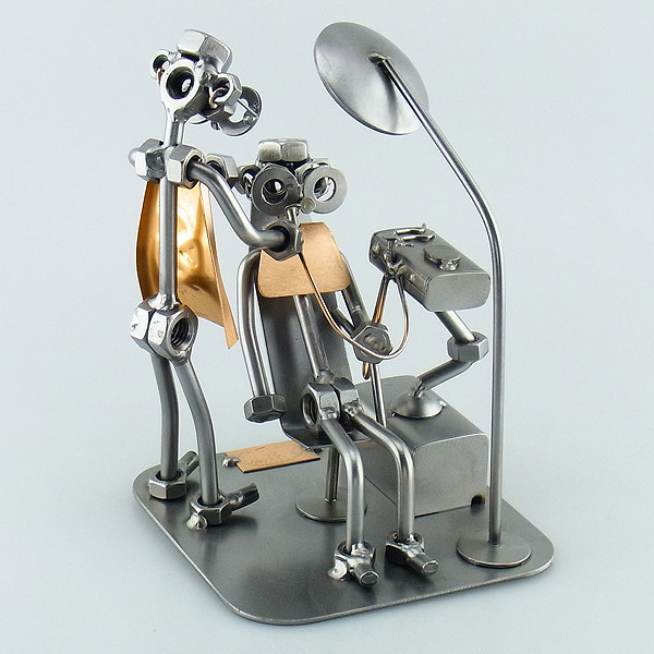 A photo of a Steelman Dentist with a patient on the dental chair metal art figurine