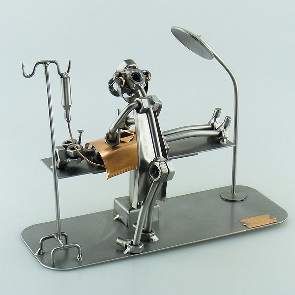 Steelman Surgeon performing a surgery on a patient metal art figurine
