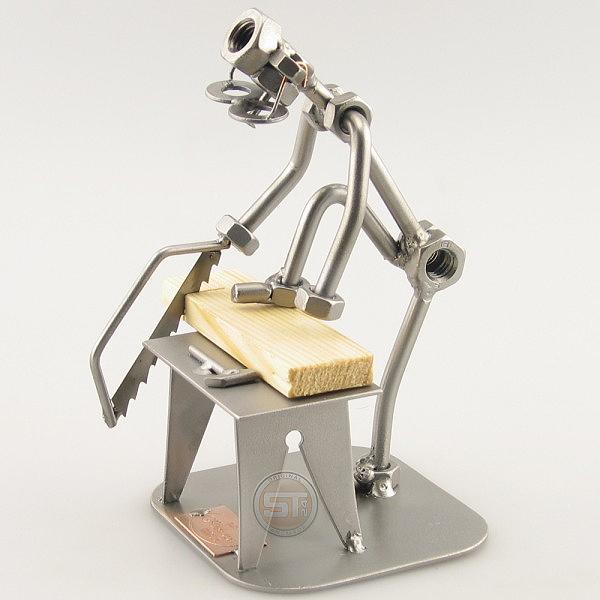 Do-It-Yourself SteelMan sawing a board metal art figurine