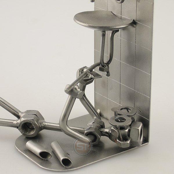 Steelman Plumber repairing under the sink metal art figurine