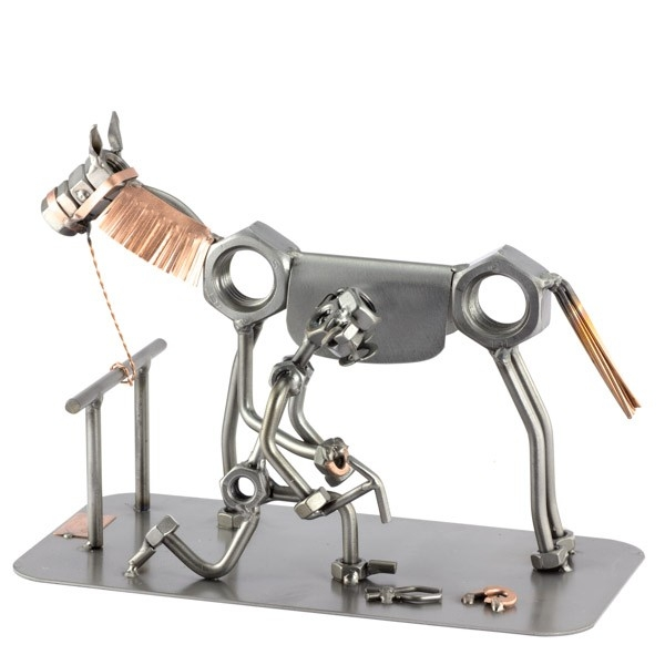 A photo of a Steelman Farrier fitting a horseshoe to his horse's hoof metal art figurine