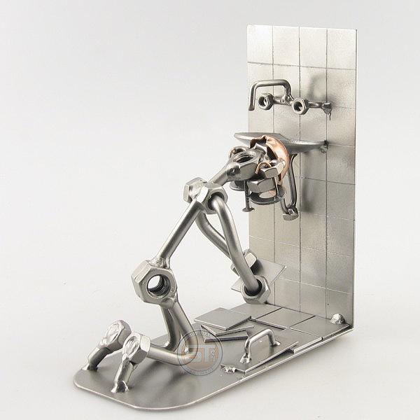 Steelman Tiler tiling a bathroom floor metal art figurine