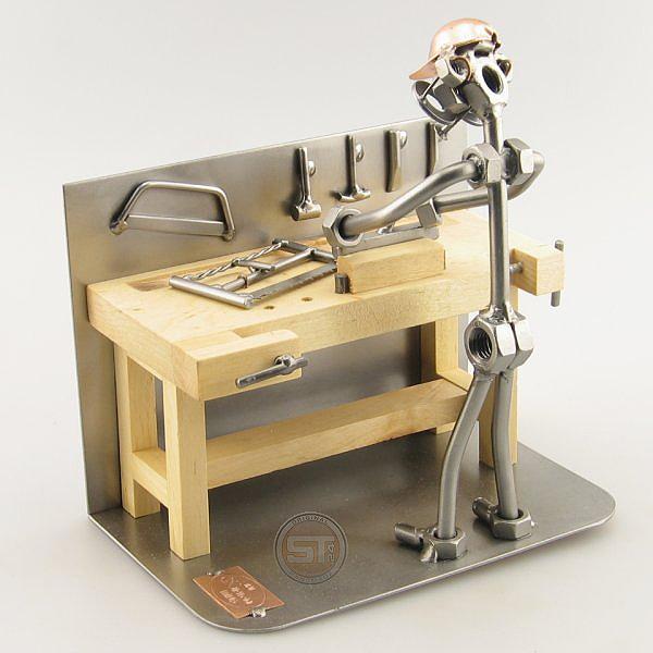 A photo of a Steelman Carpenter at his work bench metal art figurine