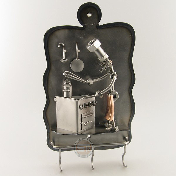 Steelman cook working over the stove metal art with Hooks