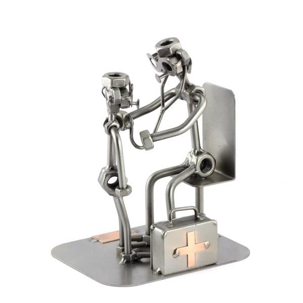 A photo of a Steelman Pediatrician with a little patient metal art figurine