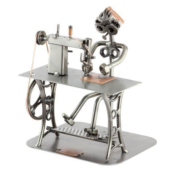Steelman Seamstress sitting a her sewing machine metal art figurine