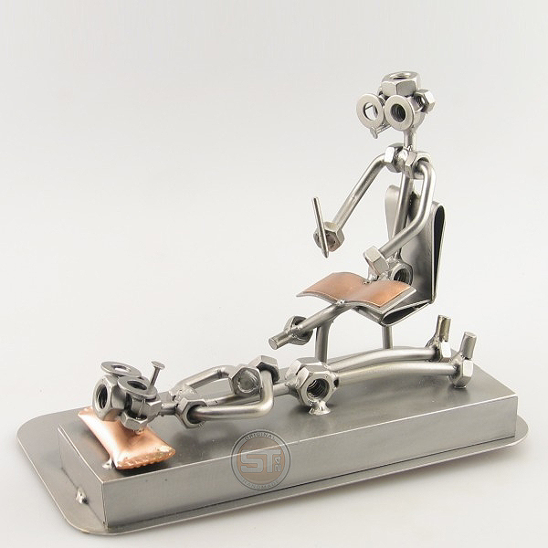 A photo of a Steelman Psychologist with a patient metal art figurine
