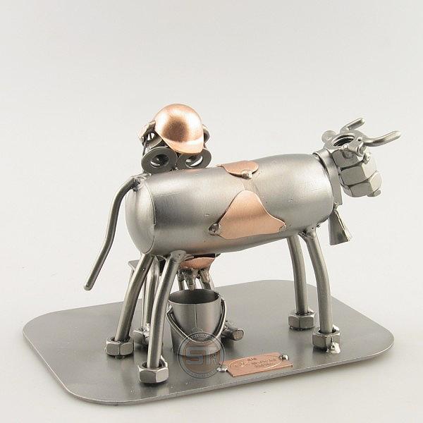 Steelman Dairy Farmer milking a cow metal art figurine