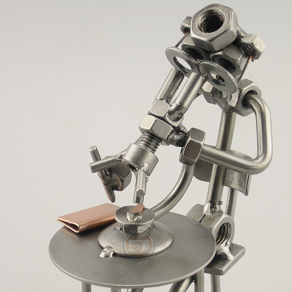 A photo of a Steelman Biologist peering through the Microscope metal art figurine