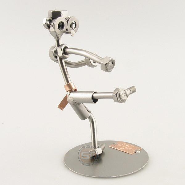 Steelman karate student in a high kick position metal art figurine