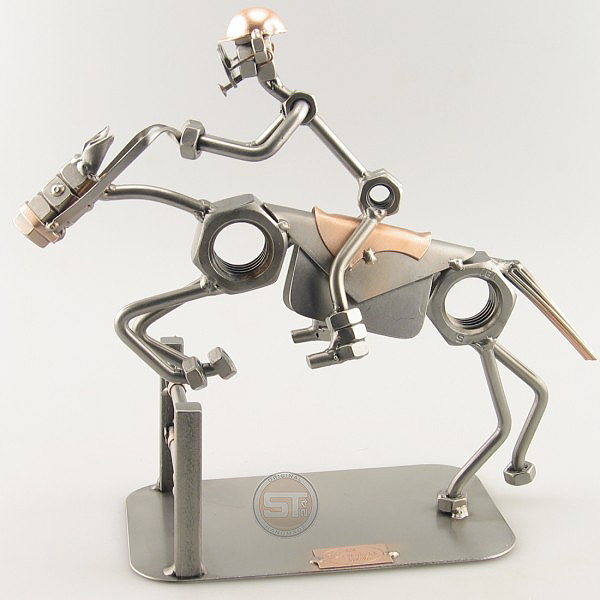 A photo of a Steelman Equestrian on a horse jumping over a fence metal art figurine