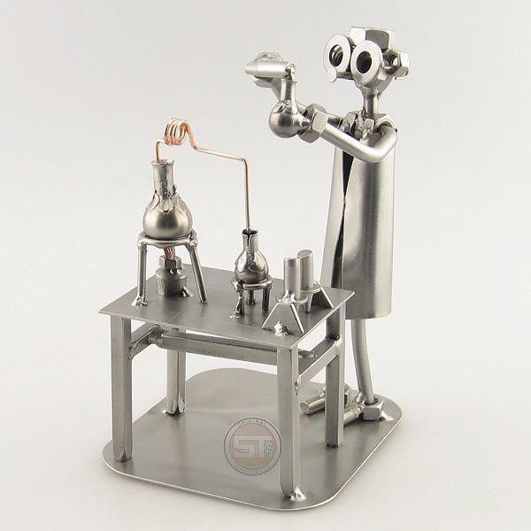 A photo of a Steelman Chemist in his lab station metal art figurine