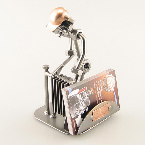 Steelman Heating Technician installing a radiator metal art figurine with a Business Card Holder