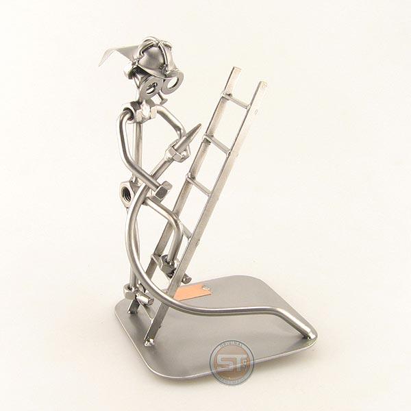 Steelman Fireman holding a hose climbing a Ladder metal art figurine