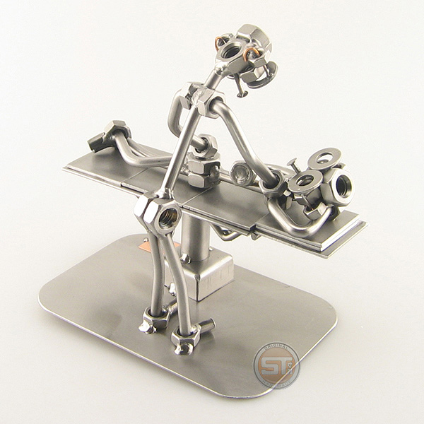 A photo of a Steelman Chiropractor with a patient metal art figurine
