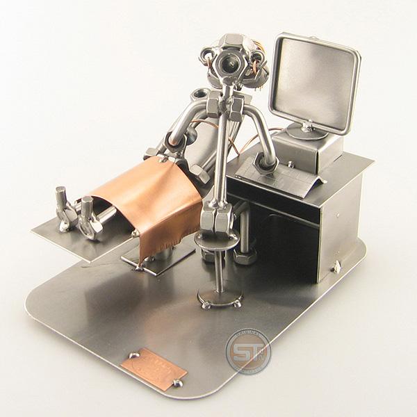 A photo of a Steelman Gynaecologist doing an ultrasound to a patient metal art figurine