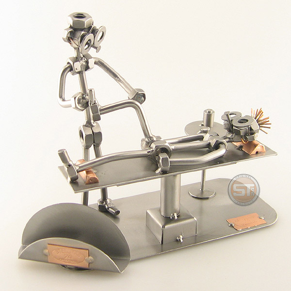 Steelman Physical Therapist working on a patient metal art figurine with a Business Card Holder