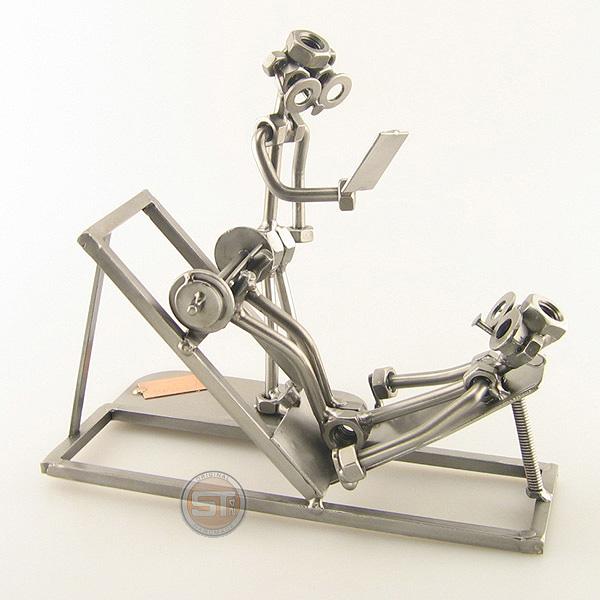 Steelman Fitness Trainer assisting a client metal art figurine