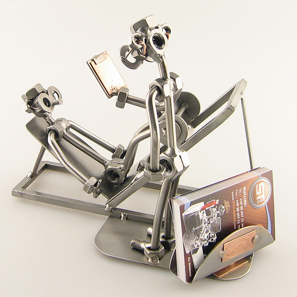Steelman Fitness Trainer assisting a client metal art figurine with a Business Card Holder