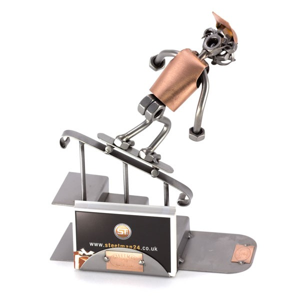 Steelman Skateboarder Grinding down a rail metal art figurine with a Business Card Holder