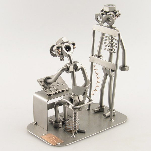 A photo of a Steelman Radiologist x-rays a patient metal art figurine