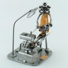 A photo of a Steelman Dentist Technician making dentures in his lab metal art figurine
