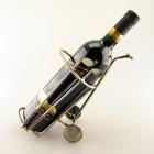 Steelman serving wine with a Wine Server metal art