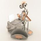 Steelman Engineer evaluating his project metal art figurine with a Desk Organizer