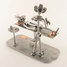 Steelman Dentist with a patient on the dental chair metal art figurine