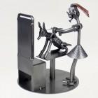 Steelman Hairdresser working on a customer in front of a Mirror metal art figurine