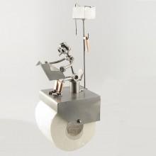 Bathroom Tissue Dispenser with a SteelMan sitting in the Restroom above reading metal art figurine