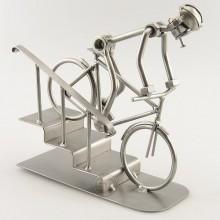 Steelman on a Mountain Bike going down a few steps metal art figurine