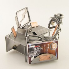 A photo of a Steelman working at his computer and talking on the phone metal art figurine with a Business Card Holder