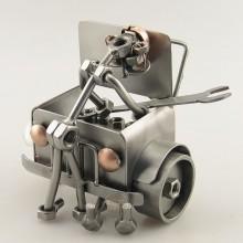 Steelman Mechanic fixing under a hood of a car metal art figurine