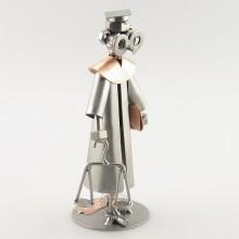 Steelman Law Graduate holding a scale metal art figurine