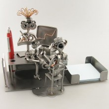 A photo of a Steelman with his secretary sitting on his desk metal art figurine with a Desk Organizer