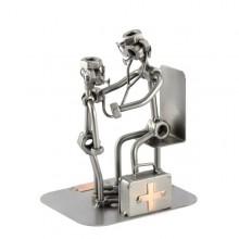 Steelman Pediatrician with a little patient metal art figurine