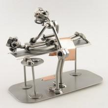 Steelman Masseur kneading the back of a patient metal art figurine