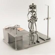 Steelman Doctor with a patient metal art figurine