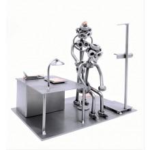 Female Steelman Doctor with a patient in her office metal art figurine