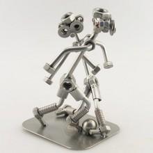 Two Steelman soccer players on a match metal art figurine