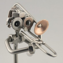 Steelman Trombonist playing his trombone metal art figurine