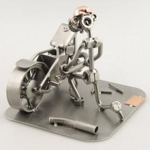 Steelman fixing a motorcycle metal art figurine