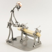 Steelman Carpenter working with a Saw on his workbench metal art figurine
