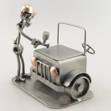 Steelman spray painting a car metal art figurine